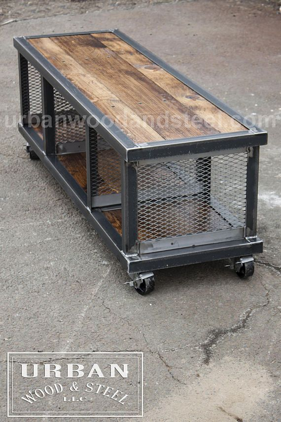 Reclaimed pine, raw steel, flat expanded metal, and 3 inch locking steel casters make this coffee table/ bench/ hall organizer/ electronics console awesome. Put your magazines, drinks, DJ equipment or feet on this unique unit. DIMENSIONS: 55 w x 17d x 18h *last photo shows unit