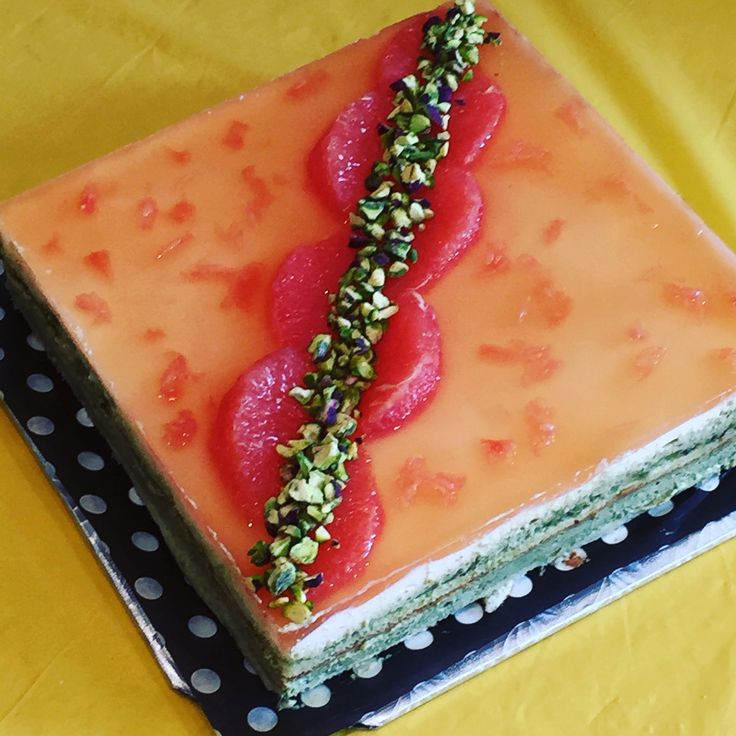 Pistachio cream and grapefruit mousse cake