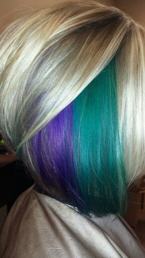 Loving the purple and teal hair color! Even the cool blonde highlights. (This is totally my head!)