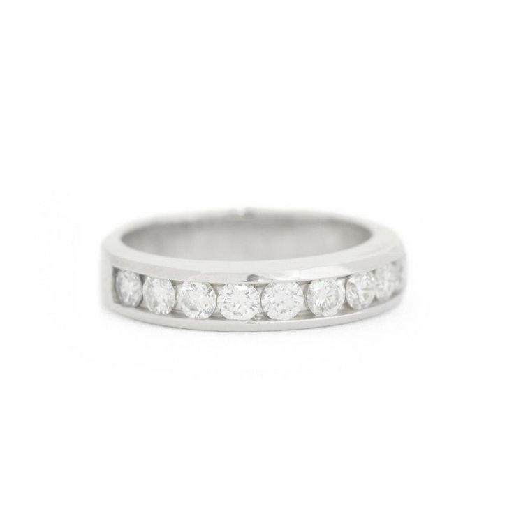 18k white gold band with channel set diamonds