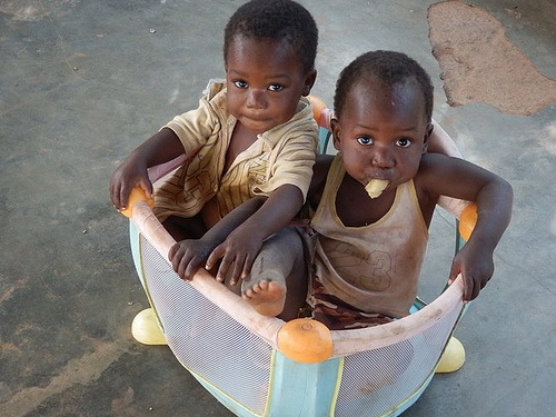 "These two adorable brothers live in a Nutritional Center in Niassa, Mozambique. Miguel and Arcanjo lost their mother at birth and ""are two great fighters!"" Photo credit: Mariana Rosa."