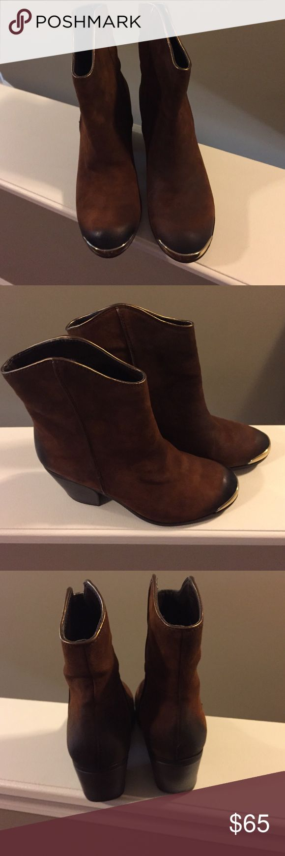 Fergie booties. New in the box. Brand new, in the box. Fergie brand cinnamon/ tobacco colored booties. Super cute, I have them in another color and always get compliments when I wear them. Fergie Shoes Ankle Boots & Booties