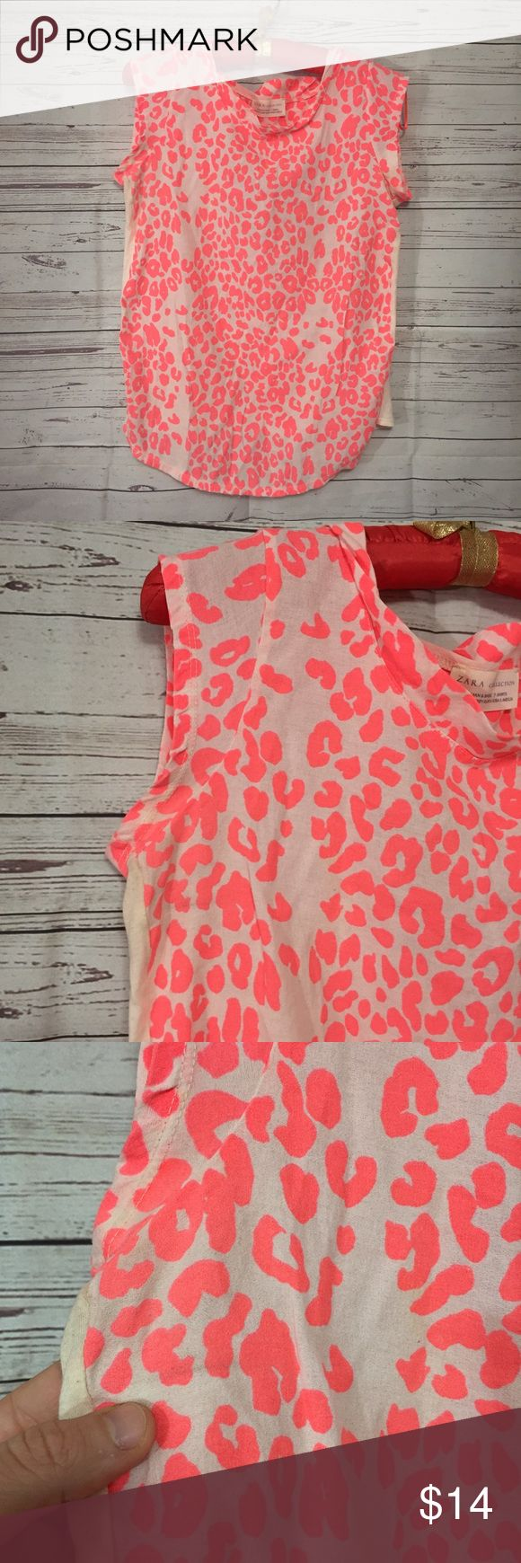 "Zara sleeveless neon orange cheetah blouse small Women's casual sleeveless blouse, sleeveless - overall white with all over neon orange cheetah print on the front. Women's size small. Back with shoulder keyhole.   **Small mark under armpit - please review image**  All measurements approximate.  Armpit to armpit (one side): 16.5"" Length from shoulder: 26"" Zara Tops Blouses"