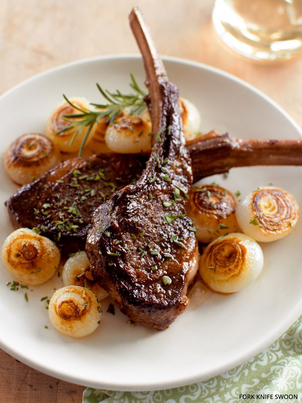 A recipe for quick Pan-Seared Lamb Chops with fresh herbs and caramelized Cippolini onions.