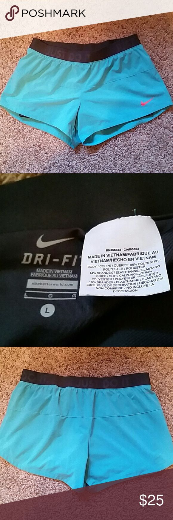 """*NWOT 2 in 1 Nike size L Dri-Fit teal shorts *NWOT 2 in 1 Nike size L Dri-Fit teal shorts. Shorts contain grey attached spandex underneath. Grey waistband states nike saying: """"just do it"""". Was given these as a gift and sadly outgrew them before wearing them. Perfect for running! These shorts are a great buy in excellent condition! :) Nike Shorts"""