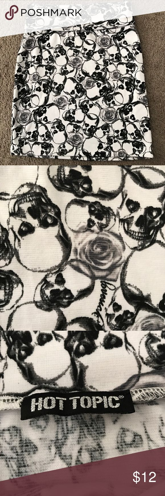 Hot Topic skull and rose mini skirt Hot Topic mini skirt. White with skulls and roses. Fold over top. Very gently used, in great condition!! Sorry no trades. Thanks for shopping! Hot Topic Skirts Mini