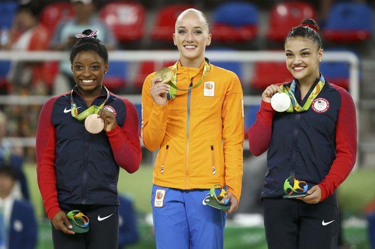 <p>Gold medallist Sanne Wevers of Netherlands (C), silver medallist Laurie…