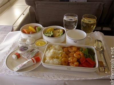 Shanghai To Seoul Cantonese prawn curry with rice and vegetables. Smoked halibut and chicken. Melon mix for dessert.