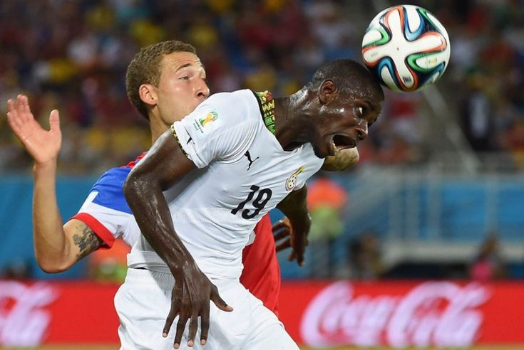 Ghana's defender Jonathan Mensah (Right) heads the ball in front of US defender Fabian Johnson during a Group G football match between Ghana...
