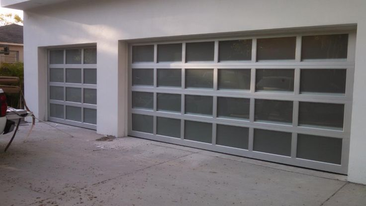 Increase curbside appeal with a modern look. These Overhead Door 521 Aluminum Garage Doors can be customized with different windows to match your home. | Model 521 | Modern Aluminum Collection | Learn more at overheaddoor.com