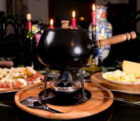 Fondue Party Guide: 30+ Recipes, Dippers, Toppings & Tips - Pair fondue with some festive holiday cocktails for your next Christmas Party