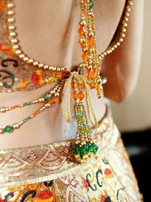 Delicate beading on this bride's wedding outfit. The gold looks beautiful with the green and orange.