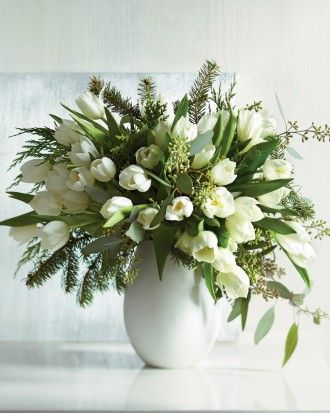 Winter Tulip Arrangement: The holidays may be over, but with this arrangement you can extend the season's charms -- and its fragrant greenery. Just snip some branches off the Christmas tree before it heads to the compost heap, and place them in a vase. To offset the fir's stiffness, add cedar and seeded eucalyptus. Finally, the luxurious touch: a few dozen white tulips from your florist. Voila: a fresh display to welcome the New Year.