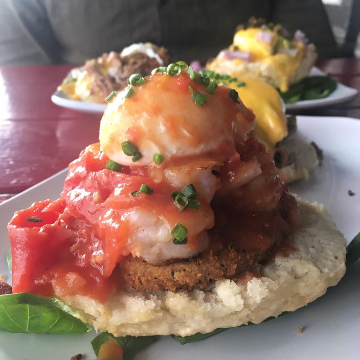 Shrimp Boogaloo Benedict: sautéed shrimp with pork tasso fried green tomatoes a buttermilk biscuit and a poached egg with creole tomato courtbouillon sauce [OC] [2896 x 2896]