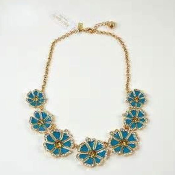 Kate Spade Floral Necklace Beautiful turquoise blue enamel , Crystal and champagne colored stones on a gold tone chain with a lobster claw closure.  18 inch in length NWT kate spade Jewelry Necklaces