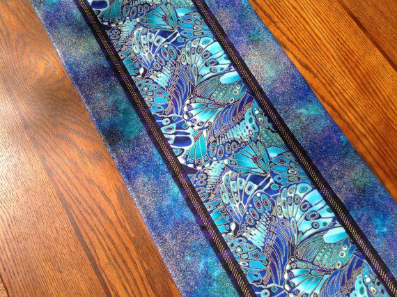 Butterfly Wings in Iridescent Blues and Purples grace this table runner be Alidan Creations