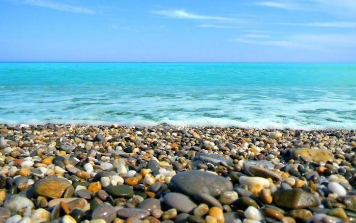 Small Rocks On The Beach Ocean Waves Blue Sky Cute Wallpapers For Lock Screen Summer Wallpaper Summer Desktop Backgrounds Beach Wallpaper