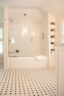 Love the glass in place of a shower curtain and the built-in storage for towels.  My bathrooms never have enough room for towels.