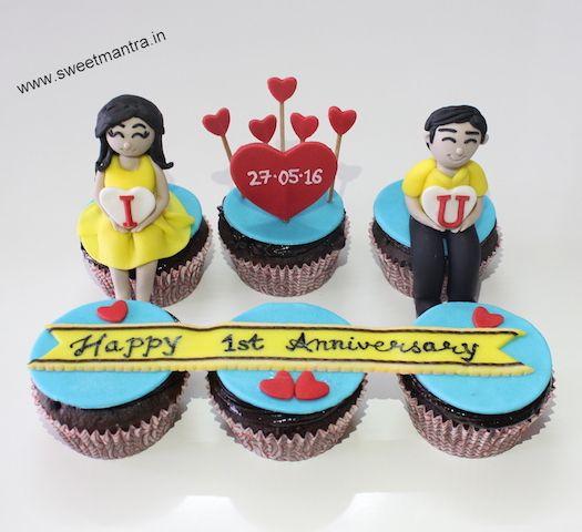 1st Wedding Anniversary,Love,Valentine theme customized designer fondant cupcakes with 3D boy and girl figurines at Balewadi, Pune