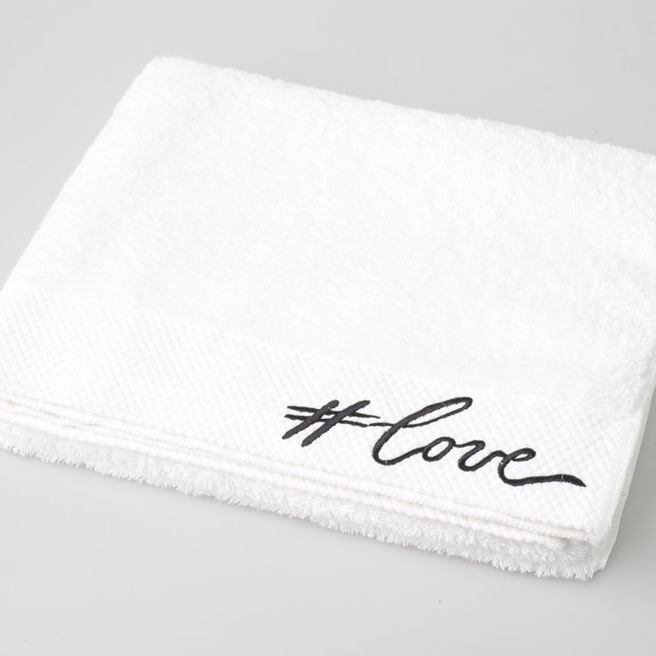Inscribed #love typography embroidered towel.