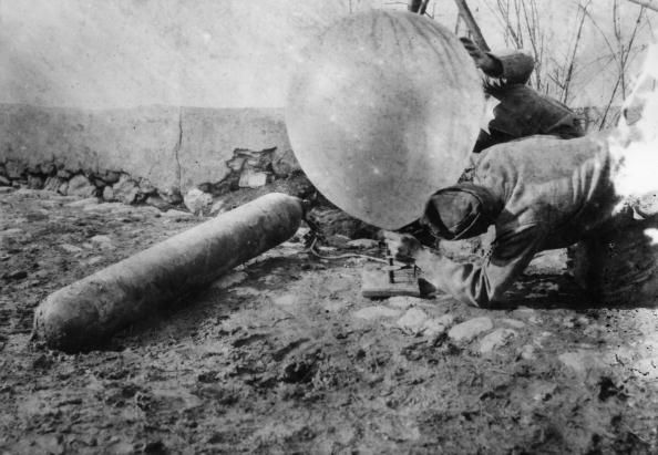 WWI; Austrian soldiers in Albania filling a balloon with gas. -Getty