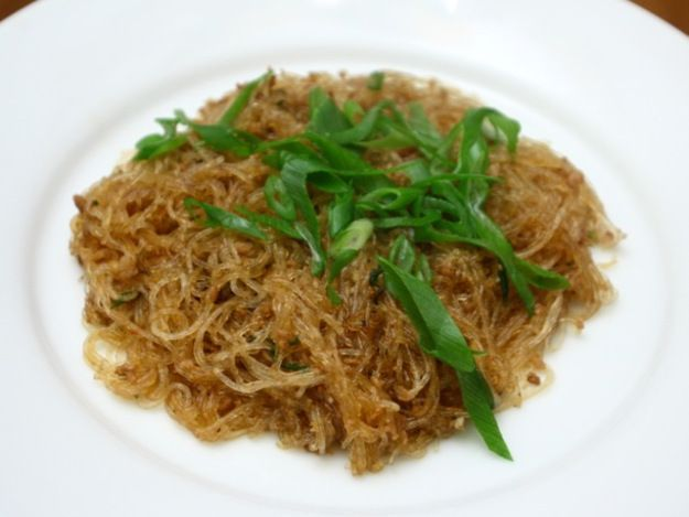 """Mayi shang shu apparently translates into English as """"ants climbing in trees."""" Don't worry, no actual ants are involved: the pork clings to the noodles like ants on a tree.  We usually use ground turkey and I decrease the sambal to 1/2-1 tsp."""