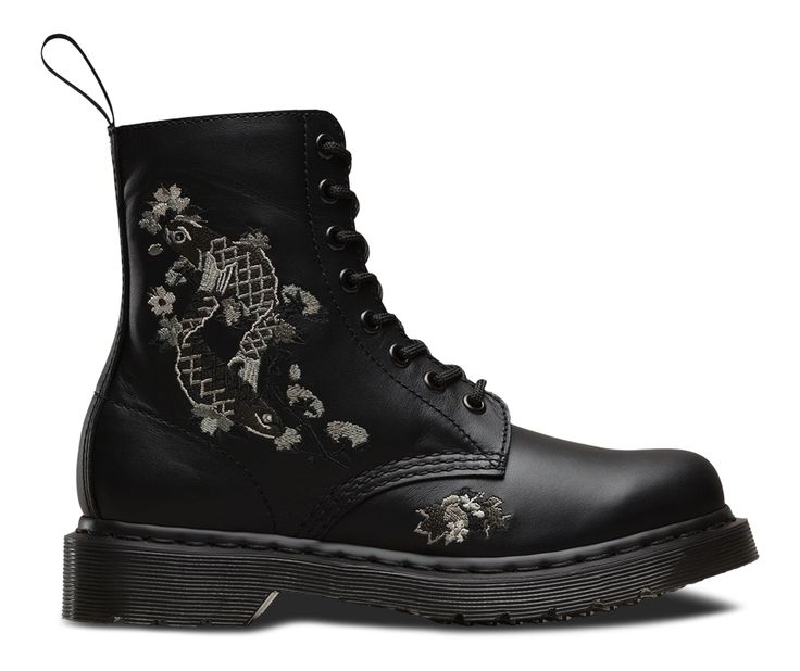 Just as in the 80s, influential stylist Ray Petri had a penchant for worker boots with floral motifs, this season we've been inspired by intricate patterns and designs played out over boots. The 8-eye Amylee boot embraces appliqué Japanese tattoo art and optional ribbon laces.