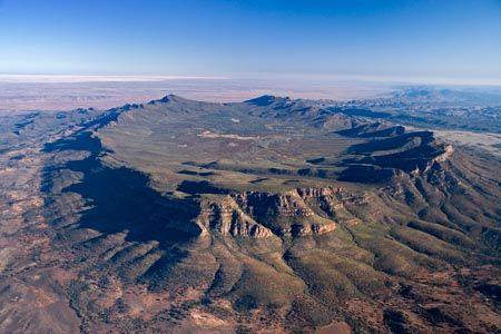 Wilpena Pound, Flinders Ranges, South Australia, Australia - aerial. Wilpena Pound is a 80 square km natural basin, a sunken elliptical valley ringed by gnarled ridges of rock