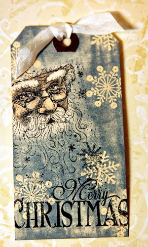 Christine Ousley version of a Tim Holtz 12 days of Christmas tag.  Ranger inks and Copic marker  were used to make the tag.