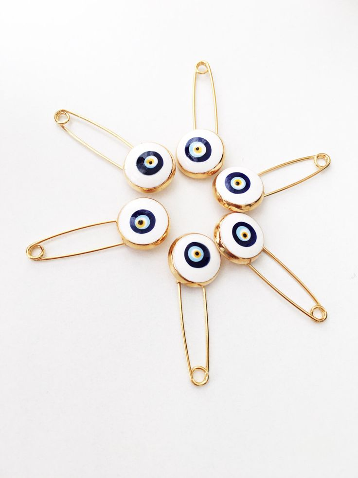 A personal favourite from my Etsy shop https://www.etsy.com/listing/477670422/5-pcs-evil-eye-safety-pin-white-lucky