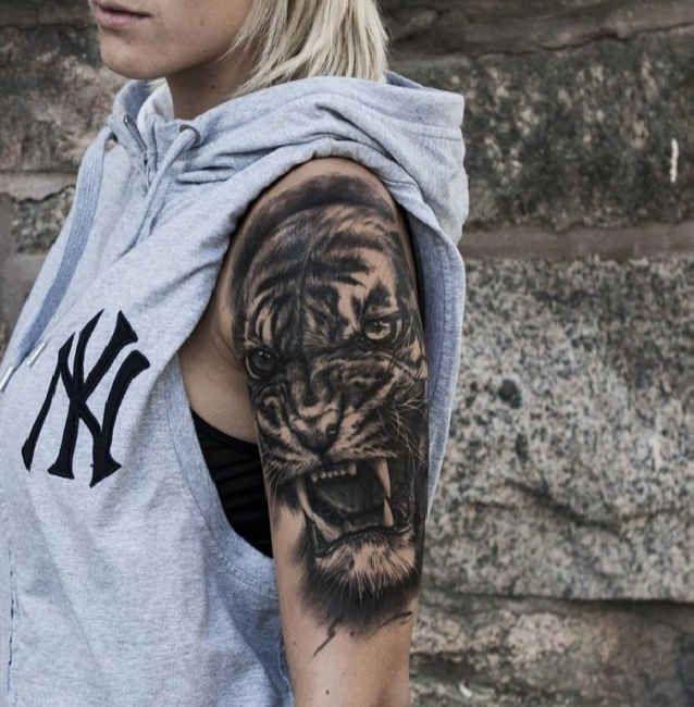 Woman with lion Tattoo upper arm  - http://tattootodesign.com/woman-with-lion-tattoo-upper-arm/  |  #Tattoo, #Tattooed, #Tattoos