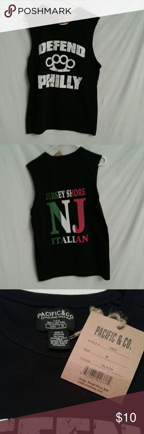 NWT men's black sleeveless tee sz M Pacific & Co sleeveless, 100% cotton men's tee sz M. The front has Defend Philly and a set of brass knuckles done in distressed white lettering. The back has Jersey Shore NJ Italian done in green white and red, like the Italian flag. This new shirt has a retro vibe. Pacific & Co Shirts Tees - Short Sleeve