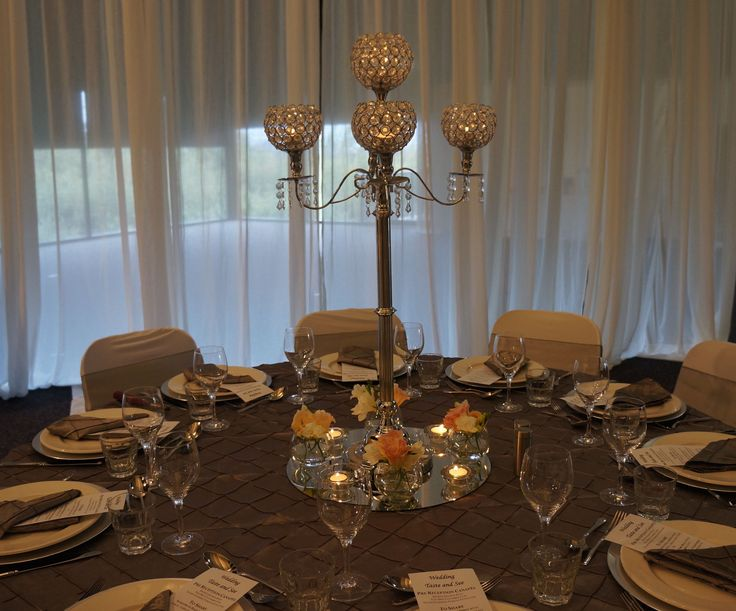 Love the silver candelabra, the pin tuck overlay, silver under plates.  http://www.tailracecentre.com.au/events/bridal-workshop/