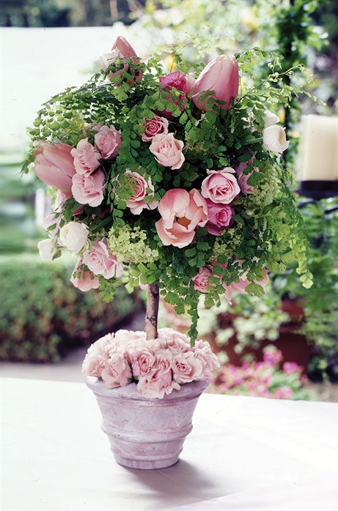 Romantic soft pink tulips paired with roses makes for a feminine display.