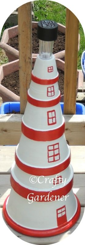 lighthouse made from clay pots. tutorial for clay pot lighthouse #garden goodies http://www.craftygardener.ca/clay-pot-lighthouse/