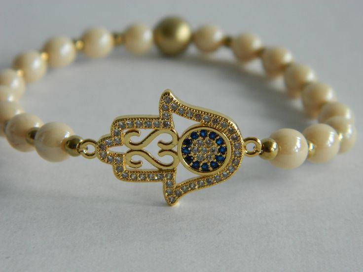 Golden hamsa/hand of fatima/kaf and evil eye/Nazar Boncuğu  bracelet in champagne luster druk bead by NadoandLola on Etsy