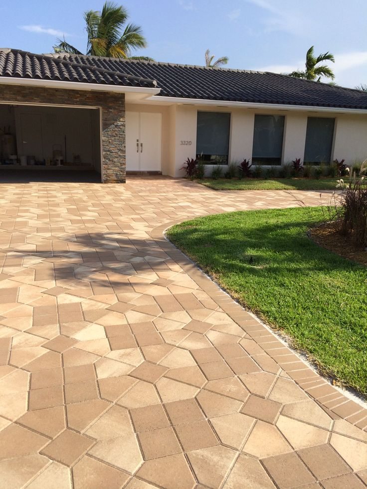 Gorgeous home with landscape & paver driveway design & build by ...