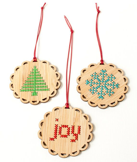 Add some cross stitch to your holiday decor! Stitch up one of these easy and quick DIY ornament kits to give as a handmade gift or to add a