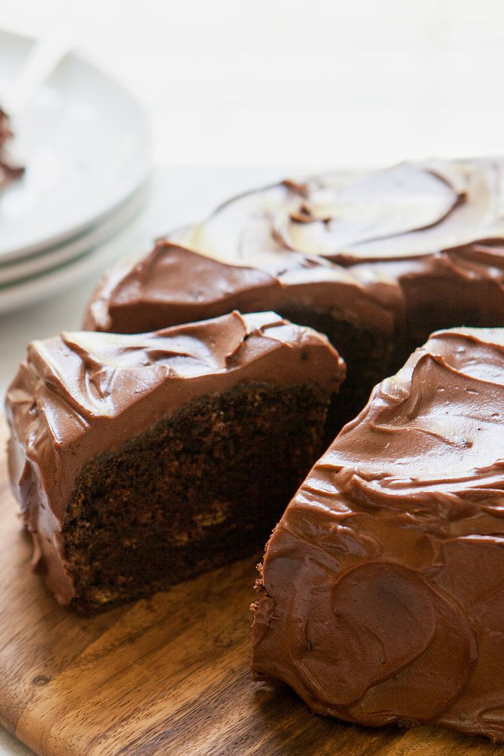 """NYT Cooking: """"A couple of years ago, my mother taught me to make her dense but moist chocolate birthday cake. She calls it 'dump-it cake' because you mix all of the ingredients in a pot over medium heat, then dump the batter into a cake pan to bake. For the icing, you melt Nestlé's semisweet-chocolate chips and swirl them together with sour cream. It sounds as if it's straigh..."""