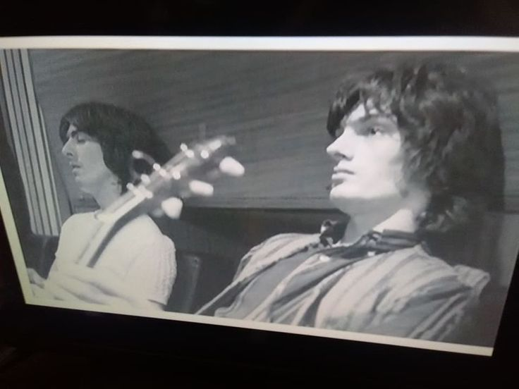 "An original screen shot taken from the documentary ""The Beatles, Strange Fruit, The Beatles' Apple Records"" Jackie Lomax & George Harrison in 1968"