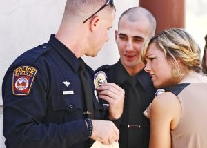 Graduation at the Pima County Sheriff's Law Enforcement Academy included a tip on the fine points  of pinning a badge.