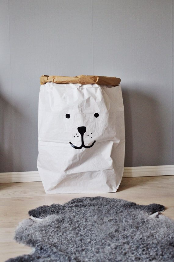 This gorgeous toy sack is made of paper, white and brown. Durable and reusable many times over. Once placed and arranged into shape, the paper bag