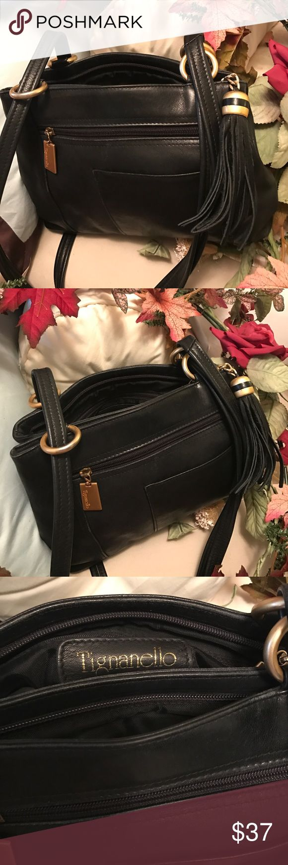 Tignanello Vintage All Leather Handbag Very nice quality, preowned, cared for, very clean vintage black leather shoulder bag. Matte Gold Hardware. Very Good condition . Excellent medium sized bag for very small investment. Two compartments and several zipper compartments as well as exterior phone pocket.? tagnanello Bags Shoulder Bags