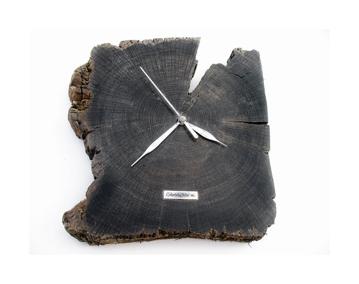 Model no 11. This clock is made of construction wood from the buildings of the Old Town of Gdansk. Black oak dating back to the 14th century. Size 30 cm x 30 cm.
