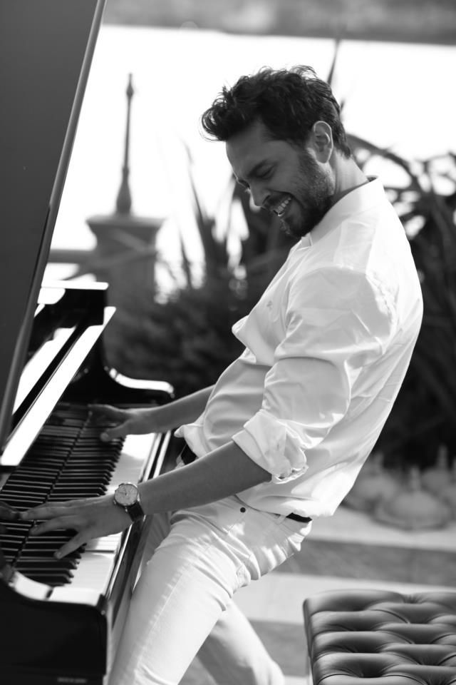 Piano man in white