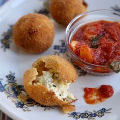 Stuffed with prosciutto, mozzarella, pecorino, herbs and lemon zest, this fried cheese balls make a zesty cocktail party hors d'oeuvres.