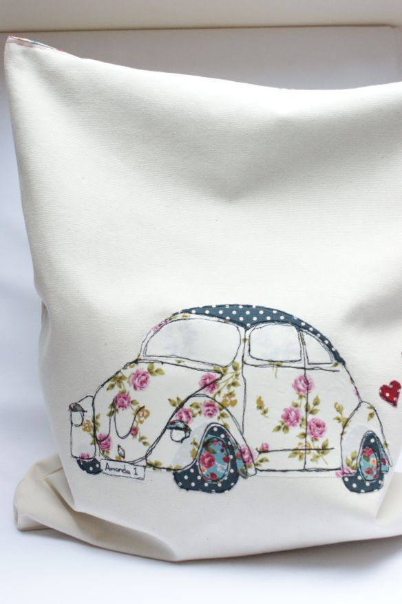 VW Bug. This is adorable. I actually want to buy a real VW Bug now and mod podge to look just like that. I'm serious.