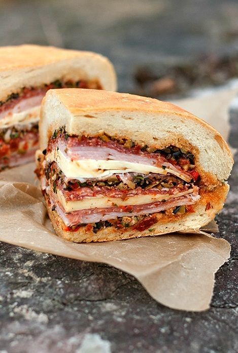 """MUFFULETTA ~~~ recipes for the olive salad, bread, and final build follow: this post's link + a focaccia option at http://honestlyyum.com/3734/muffaletta-sandwich/ + http://palachinkablog.com/muffuletta/ + that which is served at """"central grocery"""" in new orleans https://cookinginsens.wordpress.com/2012/04/05/muffuletta-sandwich-the-original-manwich/ + http://www.nolacuisine.com/2005/07/17/muffuletta-sandwich-recipe/ [USA, New Orleans, Italian-American Cuisine] [jimsgalley]"""
