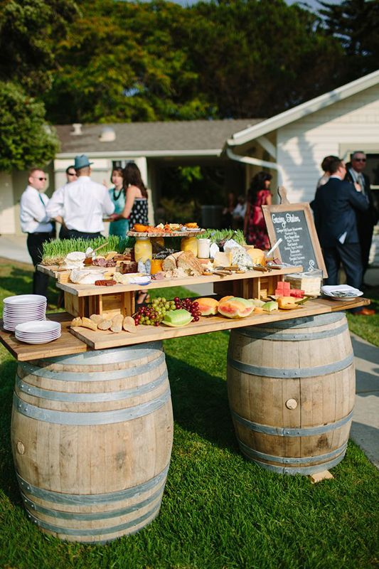 New Trend Alert: Grazing Tables on a whisky barrel stand! #weddings #food