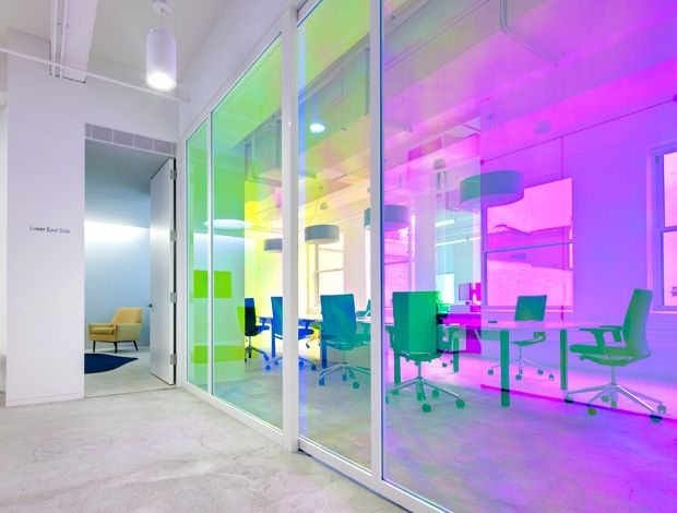 Dichroic window  film gives glass walls  a shimmering finish